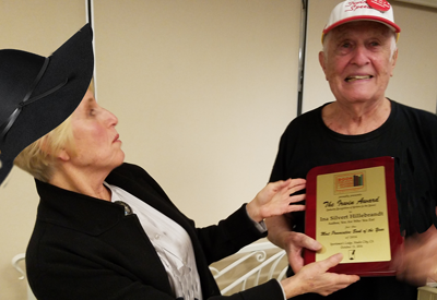 Irwin Zucker, Founder of Book Publicists of Southern California, presents Ina Hillebrandt with the coveted IRWIN AWARD, for Most Provocative Book of the Year